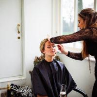 marie kelly applying makeup