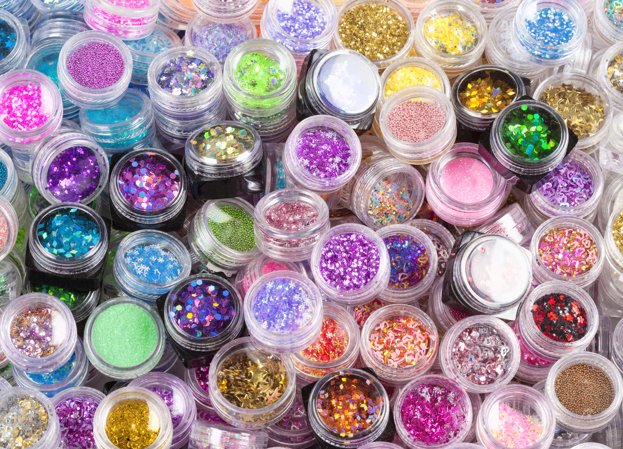 Closeup of Glitter Makeup Colours in a Box.